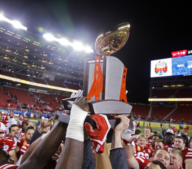 Nebraska players lift the champions trophy after a 37-29 win over UCLA during the  Foster Farms Bowl NCAA college football game Saturday, Dec. 26, 2015, in Santa Clara, Calif. (AP Photo/Marcio Jose Sanchez)